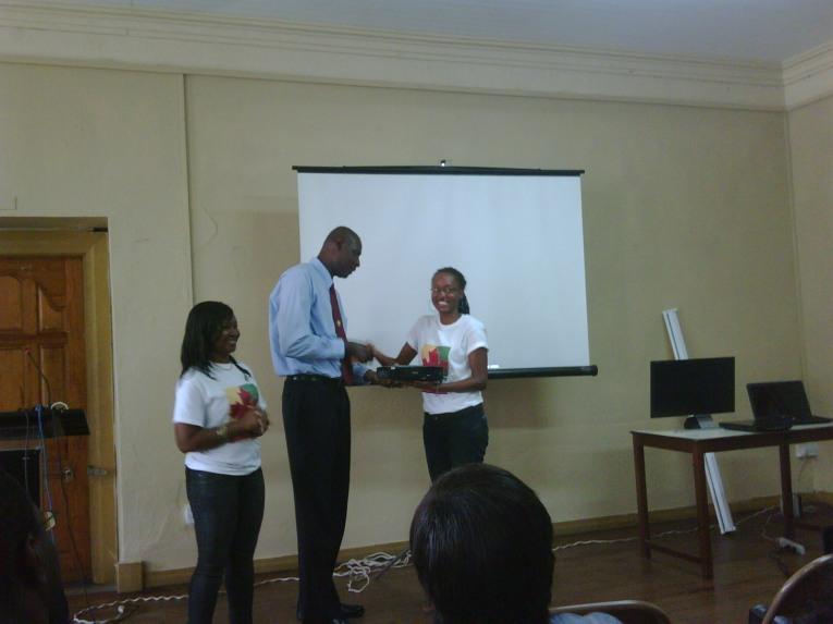 Secretary Marie Benjamin presents items to Mr. Gibbs as President, Trisha Mitchell looks on.